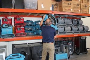 Water Damage Indian Hills Technician gathering equipment